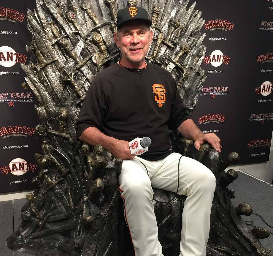 "Giants manager Bruce Bochy sits in the iron thrown from the ""Game of Thrones"" television program, which was brought to AT& Park on Wednesday ahead of Game of Thrones night on Thursday Photo: Henry Schulman, San Francisco Chronicle"