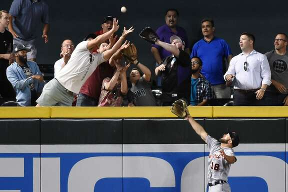 Balls are leaving the ballpark at a startling rate this season, including, above, one hit by Arizona's Brandy Drury over the glove of Detroit's Tyler Collins in May. Many pitchers say baseballs are harder and have flatter seams this season.