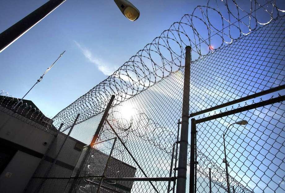 Razor wire on the fencing at the Polunsky Unit in Livingston, TX. Thursday, Jan. 5, 2012. Photo Bob Owen/rowen@express-news.net Photo: BOB OWEN, STAFF / SAN ANTONIO EXPRESS-NEWS / Stratford Booster Club