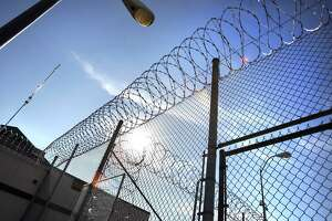 Razor wire on the fencing at the Polunsky Unit in Livingston in 2012. The prison system could benefit from an independent oversight entity.