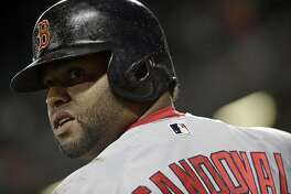 FILE - In this June 1, 2017, file photo, Boston Red Sox's Pablo Sandoval prepares for an at-bat during a baseball game against the Baltimore Orioles in Baltimore. The Red Sox on Wednesday, July 19, 2017, have released Sandoval because the third baseman didn't report after being designated for assignment last week. It officially ends the Boston tenure for the once-celebrated free agent, who never was healthy enough to live up to the expectations that came with the $95 million contract he signed in 2014.  (AP Photo/Patrick Semansky, File)