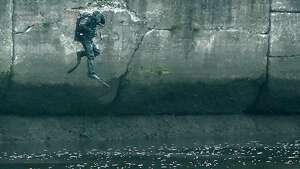 A New York State Police diver jumps in to the water as the search of the Hudson River continues for Noel Alkaramla early Tuesday morning Dec. 8, 2015 in the area of Troy, N.Y.  Alkaramla has been missing since Nov. 22nd.   (Skip Dickstein/Times Union)