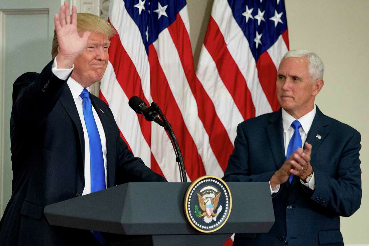 President Donald Trump, accompanied by Vice President Mike Pence, waves after speaking during the first meeting of the Presidential Advisory Commission on Election Integrity at the Eisenhower Executive Office Building on the White House complex in Washington, Wednesday, July 19, 2017. (AP Photo/Andrew Harnik)
