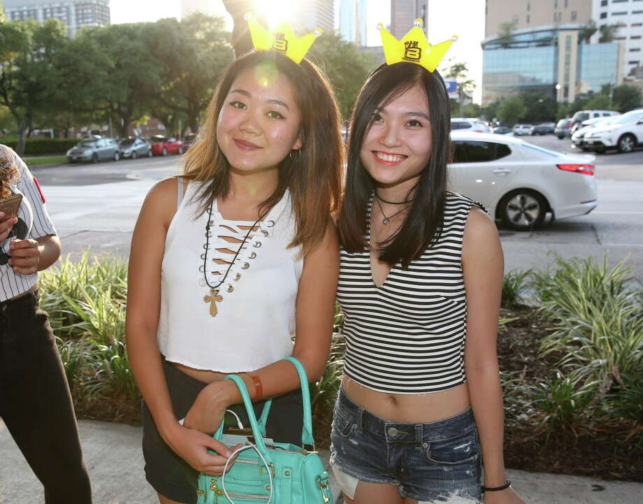 G-Dragon fans pose for a photo before the concert outside of Toyota Center Wednesday, July 19, 2017, in Houston.Click here to see 9 things you should know about the K-pop superstar. Photo: Yi-Chin Lee, Houston Chronicle / © 2017  Houston Chronicle
