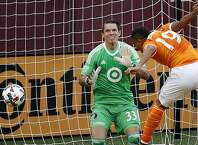 Houston Dynamo's Mauro Manotas (19) misses a scoring opportunity while heading a ball in front of Minnesota United goalie Bobby Shuttleworth during the first half of an MLS soccer match Wednesday, June 19, 2017, in Minneapolis. (Carlos Gonzalez/Star Tribune via AP)