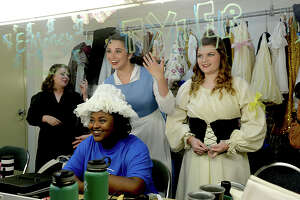 """Essence Fontenot, 18, (seated) and Emily Evans, 16, (right) react as lead character Mady Rogers, 18, jokes with them in the dressing room as cast members with the Beaumont Community Players' KIDmunity TROUPE prepare for the full dress rehearsal for their upcoming production of """"Beauty and the Beast"""" at the Betty Greenberg Center for Performing Arts Wednesday. Directed by DeeDee Howell, the popular Disney tale will run Thursday through Saturday at 7 p.m., and include a 2 p.m. matinee performance Saturday. Photo taken Wednesday, July 19, 2017 Kim Brent/The Enterprise"""