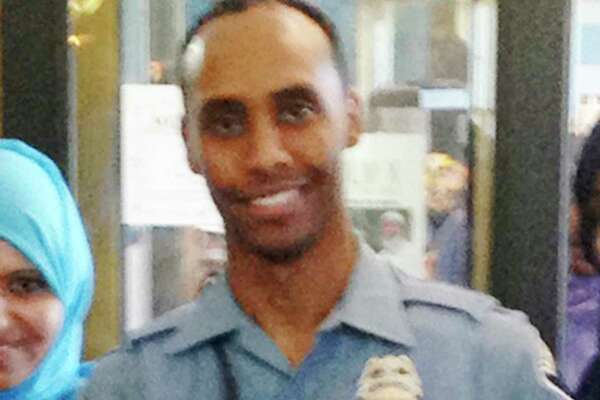 In this May 2016 image provided by the City of Minneapolis, police Officer Mohamed Noor poses for a photo at a community event welcoming him to the Minneapolis police force. Noor, a Somali-American, has been identified by his attorney as the officer who fatally shot Justine Damond, of Australia, late Saturday, July 15, 2017, after she called 911 to report what she believed to be an active sexual assault. Authorities have released no details about what led to the shooting of Damond. (City of Minneapolis via AP) ORG XMIT: CER105