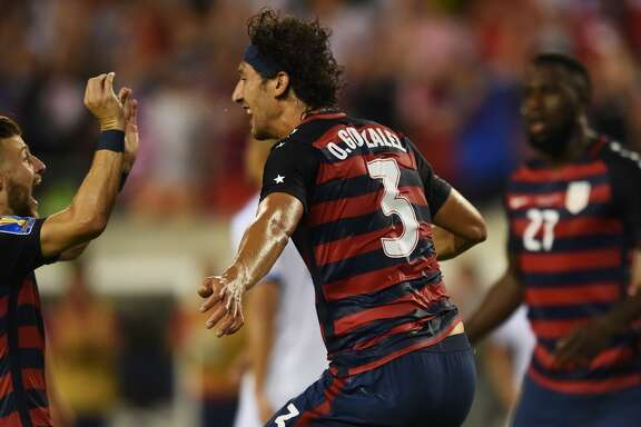 United States' Omar Gonzalez (C) reacts to scoring the first goal during their CONCACAF Gold Cup quarterfinal match against El Salvador at Lincoln Financial Field on July 19, 2017 in Philadelphia, Pennsylvania.  / AFP PHOTO / DOMINICK REUTERDOMINICK REUTER/AFP/Getty Images