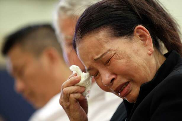 Kim Le, grandmother of Tommy Le, cries during a public forum held by the family of Le, a 20-year-old high school student who was shot and killed by King County sheriff's deputies in June, Wednesday, July 19, 2017 at the Asian Counseling and Referral Service. Family members say Tommy lived with his grandmother for several years.