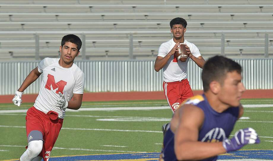 Martin quarterback Mathew Duron looks for a receiver in their 7 on 7 football game against LBJ Wednesday, July 19, 2017 at Krueger Field. Photo: Cuate Santos / Laredo Morning Times / Laredo Morning Times