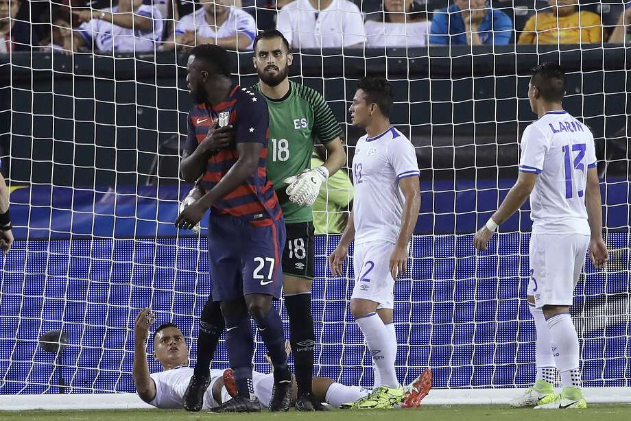 El Salvador's Derby Carrillo (18) holds Unites States' Jozy Altidore (27) as he reacts to an incident with El Salvador's Henry Romero, lying on the ground, during a CONCACAF Gold Cup quarterfinal soccer match in Philadelphia, Wednesday, July 19, 2017. Romero appeared to first bite Altidore on the back of a shoulder and then pull the American forward's nipple. Canadian referee Drew Fischer, a Major League Soccer regular, did not penalize the incident. (AP Photo/Matt Rourke) Photo: Matt Rourke, Associated Press
