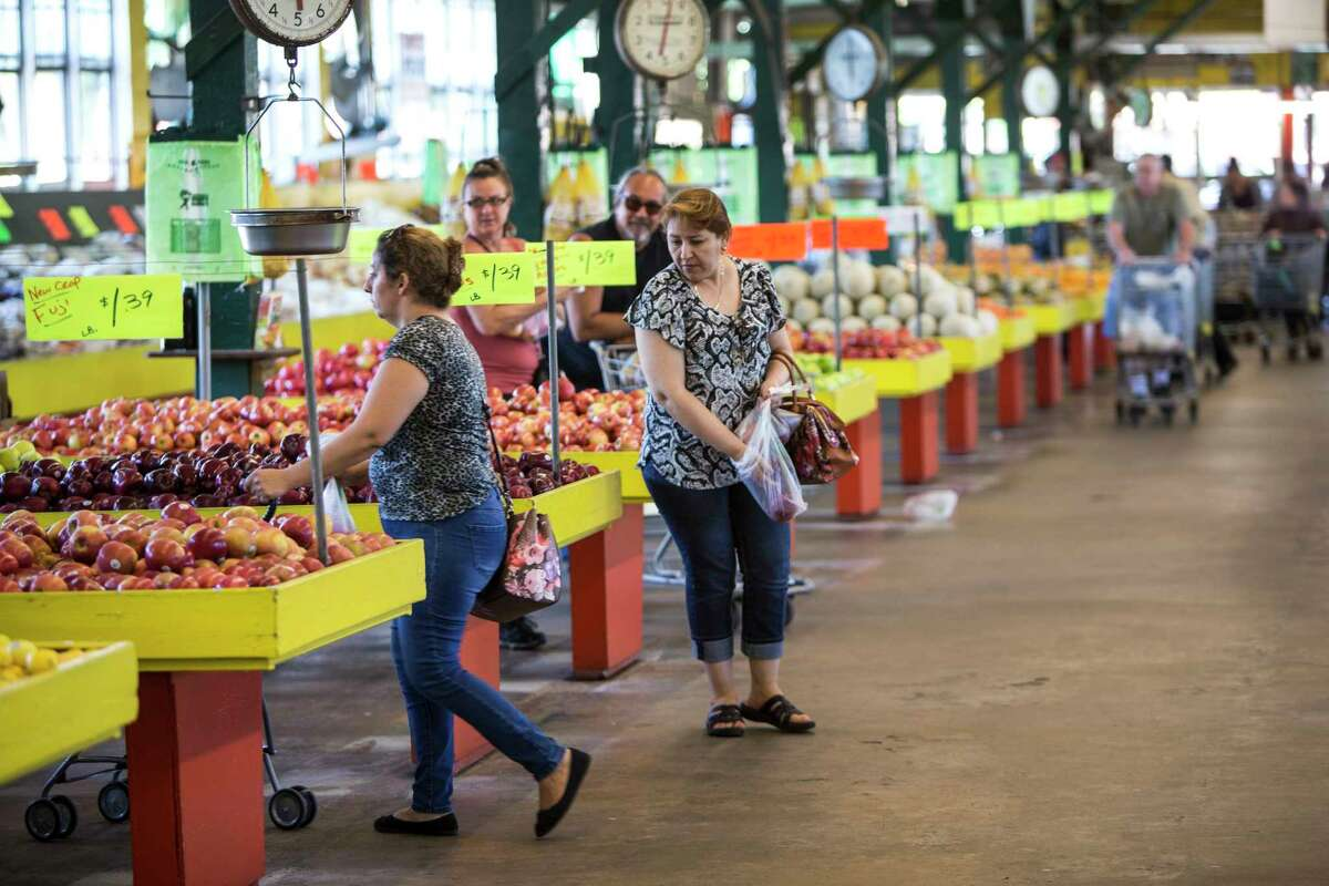Shoppers browse through the produce at Canino Produce Inc., Farmers Outlet in the 2500 block of Arline on Monday, May 1, 2017, in Houston. A local developer is under contract to purchase the farmer's market property in the Heights area. The group says the market will stay, but improvements are planned that will affect the property in the long term. ( Brett Coomer / Houston Chronicle )