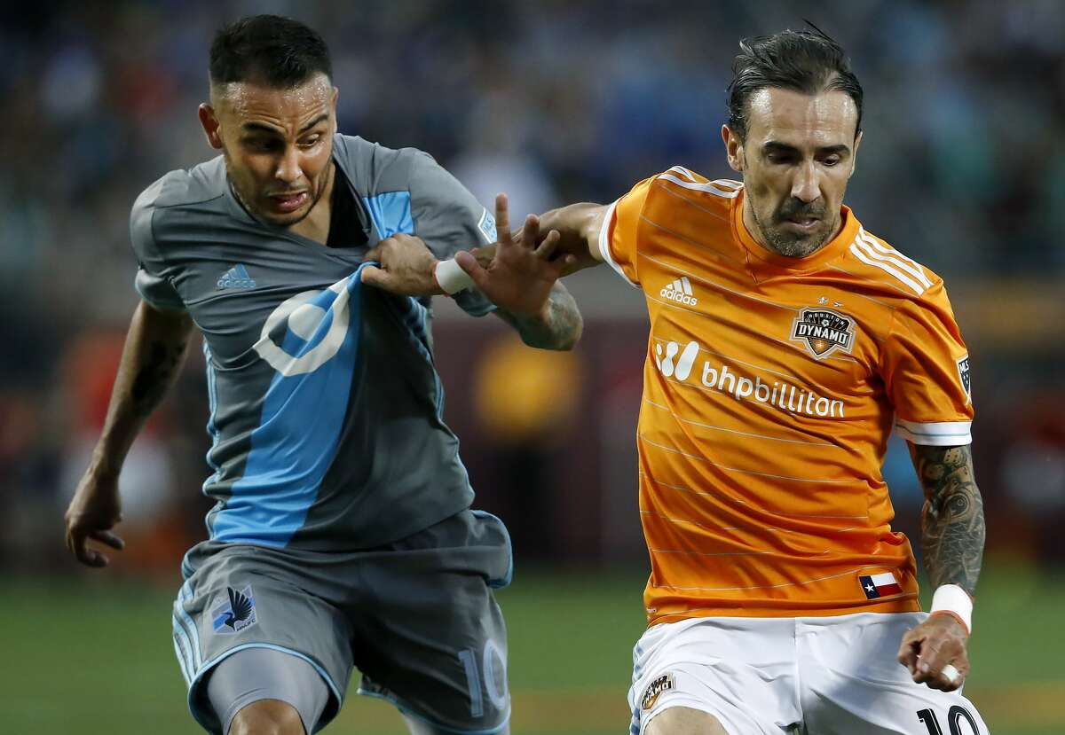 Minnesota United's Miguel Ibarra, left, and Houston Dynamo's Vicente Sanchez (10) vie for the ball during the second half of an MLS soccer match Wednesday, June 19, 2017, in Minneapolis. (Carlos Gonzalez/Star Tribune via AP)