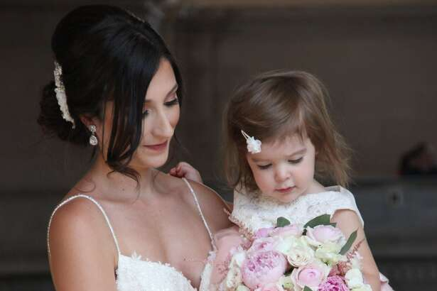 Only a few photos remain of Giavanna Acostaand Enzo Mineo's wedding Monday, following a break-in of the photographer's car in San Francisco. The couple and the photographer are hoping the memory cards from the cameras will turn up.