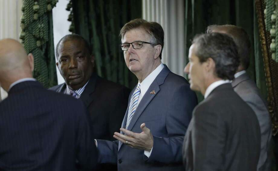 Lt. Gov. Dan Patrick, center, talks with state senators on the second day of a special session ordered by Republican Gov. Greg Abbott, in Austin, Texas, Wednesday, July 19, 2017. Conservatives in the state Senate are swiftly advancing sunset legislation, a regulatory bill that must pass before the legislature can work on anti-abortion measures, school vouchers and defanging local ordinances in Texas' big and liberal cities. (AP Photo/Eric Gay) Photo: Eric Gay, STF / Associated Press / Copyright 2017 The Associated Press. All rights reserved.