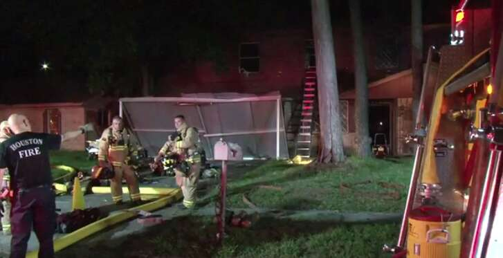 Houston police and firefighters are investigating the cause of a fire late Wednesday at a northeast Houston house, where one man was found dead. (Metro Video)