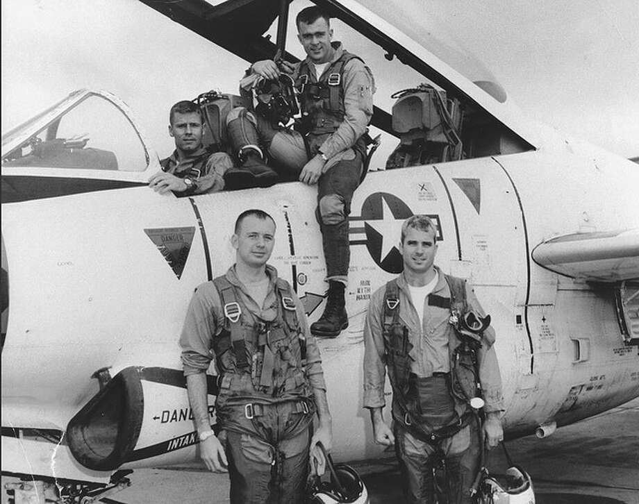 John McCain (front right) flew fighter planes for the Navy during the Vietnam War. Photo: Library Of Congress
