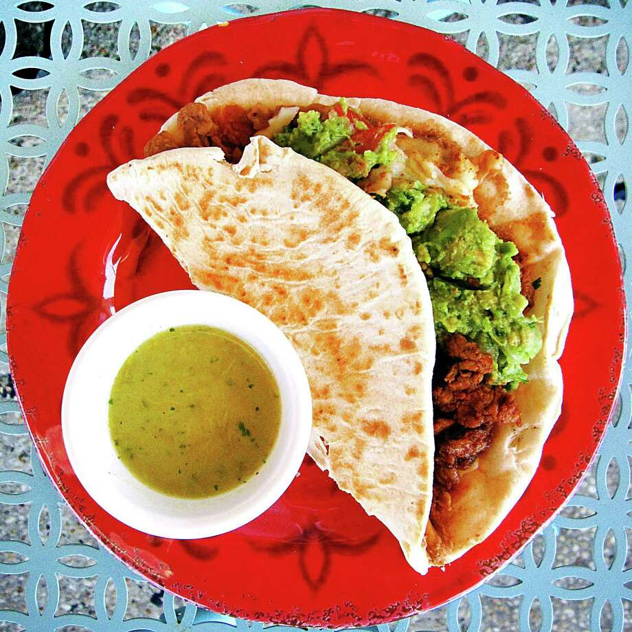 Blue Demon taco with al pastor, beans, white cheese and guacamole on a handmade toasted tortilla from Taco Libre. Photo: Mike Sutter /San Antonio Express-News