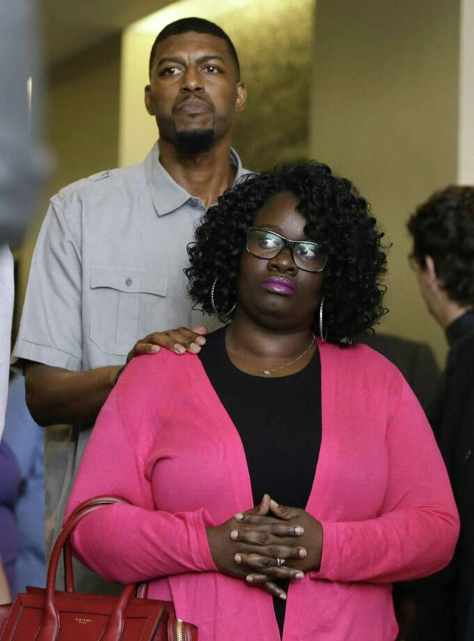 FILE - In this May 11, 2017, file photo, Jordan Edwards' parents Charmaine Edwards, front, arrives with her husband Odell Edwards for a news conference in Dallas. A white former Texas police officer has been indicted on a murder charge in the April shooting death of Edward's, who was leaving a party, prosecutors said Monday, July 17, 2017. Dallas County District Attorney Faith Johnson announced that a grand jury indicted former Balch Springs police officer Roy Oliver in the death of the 15-year-old. (AP Photo/LM Otero, File) Photo: LM Otero, STF / Associated Press / Copyright 2017 The Associated Press. All rights reserved.