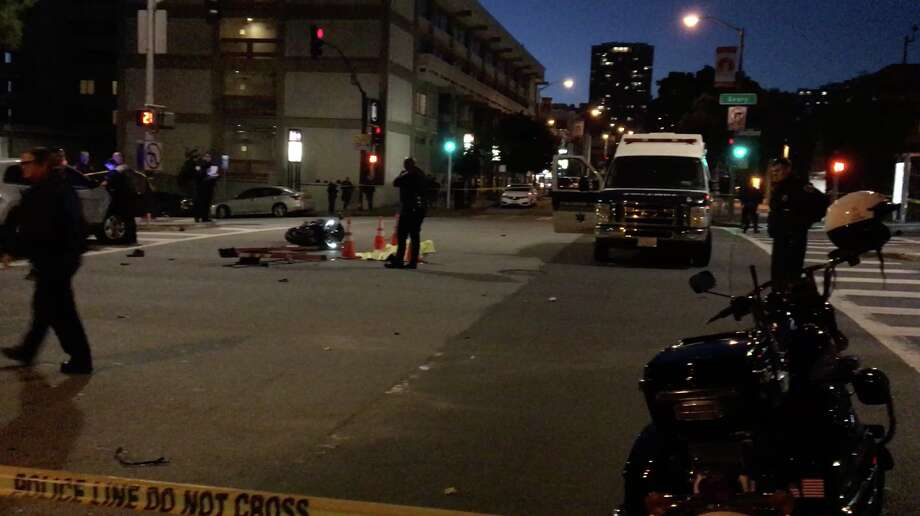 A motorcyclist died after crashing into a truck on Geary Boulevard near the Chinese Consulate on Wednesday night, July 20, 2017. Photo: Charles Desmarais / The Chronicle