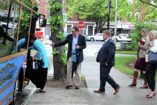 Danbury business leaders and CTNext board members get on a trolley to tour the downtown area of Danbury, Conn., on Monday, May 22, 2017.