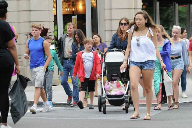 Greenwich Avenue was crowded as shoppers came out during the Sidewalk Sale Days  in Greenwich, Conn., Friday, July 14, 2017. The outdoor sales event with 120 participating merchants continues in central Greenwich Saturday from 10 a.m. to 6 p.m. and Sunday from 11 a.m. to 5 p.m.