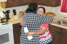 Maria Lopez is overcome with emotion as she is embraced by Habitat for Humanity-Laredo-Webb County Executive Director Carol Sherwood after receiving the keys to her new home in the Sierra Vista Subdivision, Wednesday, July 19, 2017.