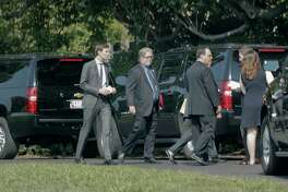 White House Senior Adviser Jared Kushner, left, and White House chief strategist Steve Bannon, center, walk to their vehicle on the South Lawn of the White House in Washington, Thursday,July 20, 2017, to join the motorcade with President Donald Trump for a visit to nearby Pentagon.