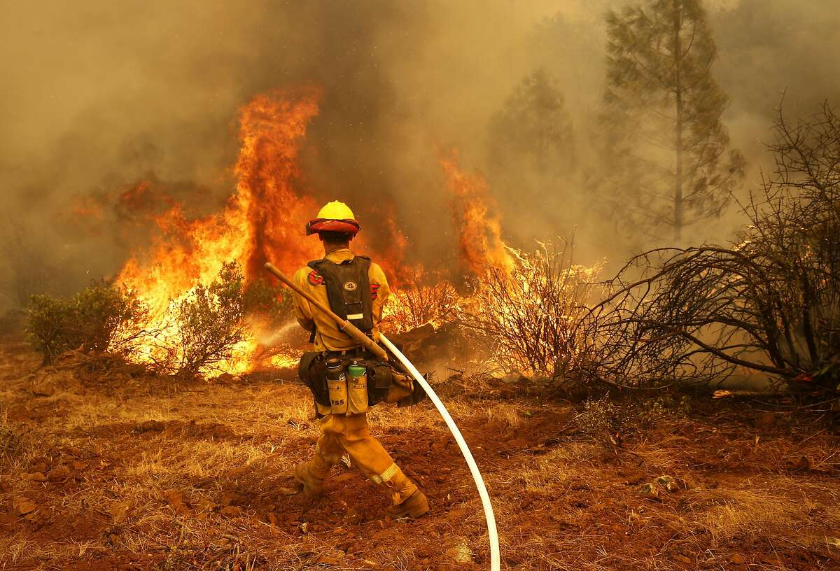FILE - Jeffrey Hernandez with Cal Fire as firefighters continue to battle the Detwiler Fire on the outskirts of Mariposa, Ca. in this file photo from Wednesday July 19, 2017.