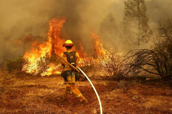 Jeffrey Hernandez  with Cal Fire as firefighters continue to battle the Detwiler Fire on the outskirts of Mariposa, Ca., on Wednesday July 19, 2017.