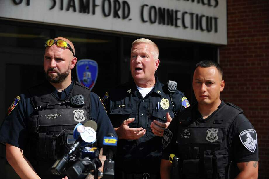 Sergeant Charles White, center, speaks during a press conference with officers Damien Rosa, right, and Michael Montanaro in front of the Stamford Police headquarters in Stamford, Conn. on Monday, July 17, 2017. Officers Rosa and Montanaro rescued a seven-year-old boy who fell off the fishing pier at Cummings Park on Sunday evening. Photo: Michael Cummo / Hearst Connecticut Media / Stamford Advocate