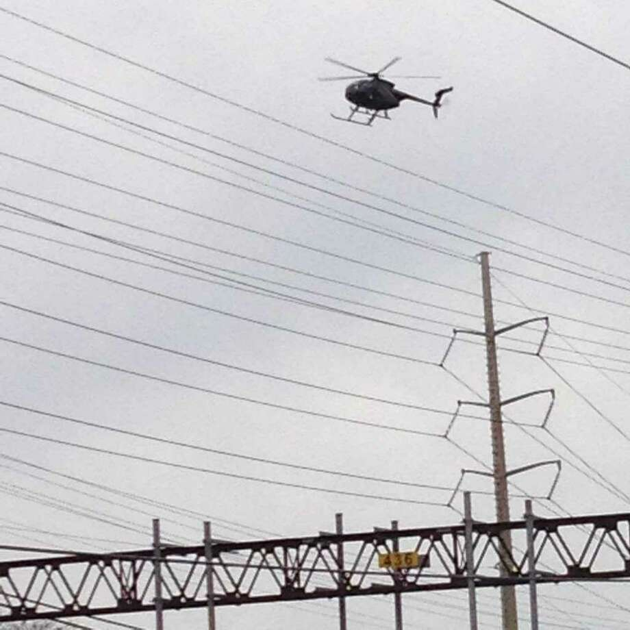 "A helicopter will be inspecting Eversource's high-voltage electrical equipment through July 26, 2017. The blue and silver helicopterhas the number N1431W on its tail. ""The work involves the use of a helicopter equipped with heat-sensing, infrared scanning technology which can detect potential equipment issues before they occur,"" it said in a news release. Photo: /"