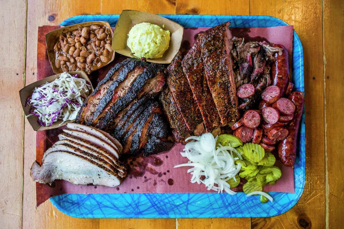 Pinto beans, potato salad, pork ribs, pulled pork, sausage, pickles, onions, brisket, turkey and cole slaw from Franklin Barbecue in Austin.