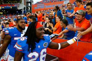 GAINESVILLE, FL - SEPTEMBER 06:  Marcell Harris #26 of the Florida Gators celebrates with fans following  the game against the Eastern Michigan Eagles at Ben Hill Stadium on September 6, 2014 in Gainesville, Florida.  (Photo by Sam Greenwood/Getty Images)