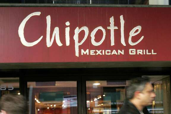 File photo of a Chipotle Mexican Grill in the Brooklyn borough of New York. A Facebook video showed one rodent scurrying across the ground at a Chipotle in Dallas, another climbing the wall and a third limp on the ground.