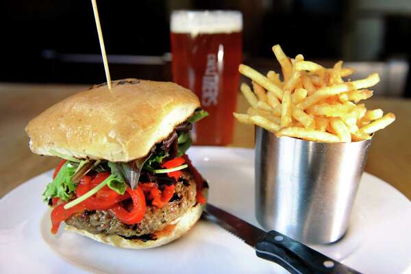 """The """"Something Greek"""" burger with ground lamb, feta, mint, shallot with confit garlic, roasted red pepper slaw, served with fries and a pint of """"All In"""" IPA on Tuesday, Oct. 16, 2012, at Druthers in Saratoga Springs, N.Y. (Cindy Schultz / Times Union)"""