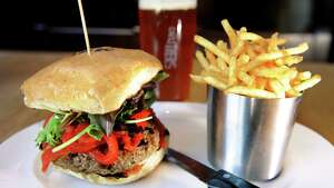 "The ""Something Greek"" burger with ground lamb, feta, mint, shallot with confit garlic, roasted red pepper slaw, served with fries and a pint of ""All In"" IPA on Tuesday, Oct. 16, 2012, at Druthers in Saratoga Springs, N.Y. (Cindy Schultz / Times Union)"