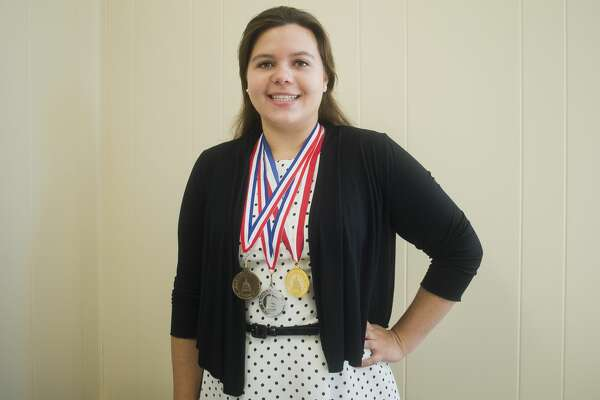 Emily Deese of Midland poses for a portrait with her bronze, silver and gold Congressional Award medals for service to the community on Wednesday, July 5, 2017 at the Midland Daily News offices.