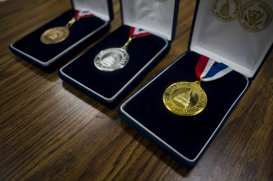 Emily Deese of Midland's bronze, silver, and gold Congressional Award medals for service to the community. Photo: (Katy Kildee/kkildee@mdn.net)