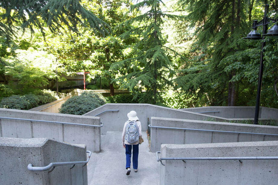 A woman walks through a maze of stairs and ramps at Freeway Park, on Wednesday, July 19, 2017. Photo: GRANT HINDSLEY, SEATTLEPI.COM / SEATTLEPI.COM