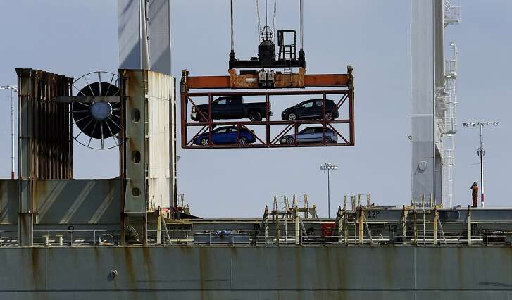 A crane transporting vehicles operates on a container ship at the Port of Oakland on Thursday, July 13, 2017, in Oakland, Calif. (AP Photo/Ben Margot)