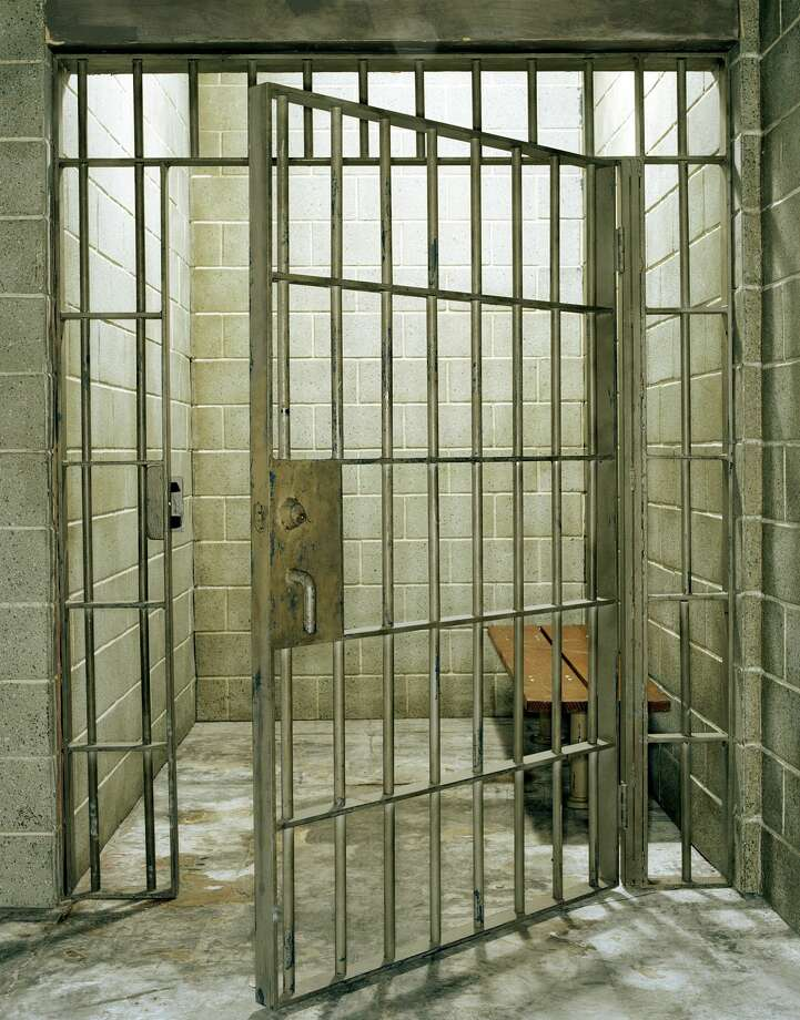 Empty prison cell with door open Photo: Michael Kelley/Getty Images