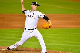 The Mariners acquired reliever David Phelps from the Miami Marlins Thursday in exchange for four prospects.