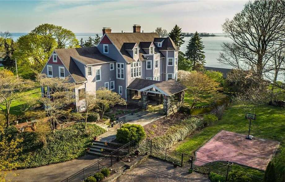 """Originally built circa 1890, the house at 35 Point Lookout in Milford, Conn. has been refurbished over the years into a 6,251-square foot home with modern amenities, including a third floor """"pub"""" with full bar. The home has as many of its original features, including its five working fire places. Photo: Contributed Photo / Contributed Photo / Connecticut Post Contributed"""