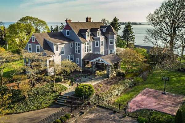 """Originally built circa 1890, the house at 35 Point Lookout in Milford, Conn. has been refurbished over the years into a 6,251-square foot home with modern amenities, including a third floor """"pub"""" with full bar. The home has as many of its original features, including its five working fire places."""
