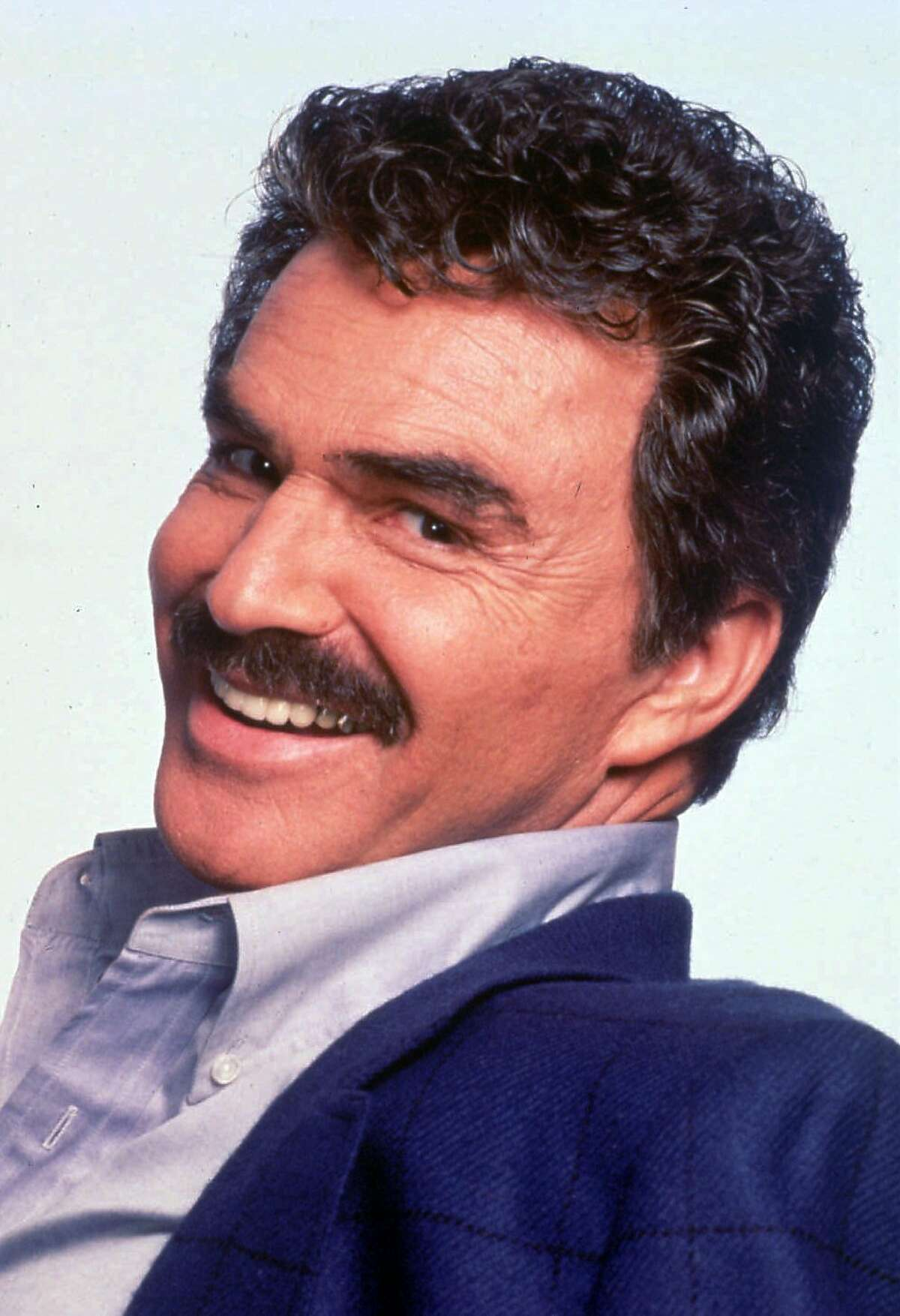 FILE--Actor Burt Reynolds took up the pen to answer a Los Angeles newspaper column on his personal turmoil and charges that he has lost his sense of humor and grace. Phil Rosenthal wrote in his Daily News column that Reynolds' ``rage is no longer filtered through the humor that once enabled his digs to tickle as they needled. His anger is raw, unwashed and ugly now, and not even his uneasy laugh afterward disguises it.'' (AP Photo/file) ALSO RAN: 11/15/97,