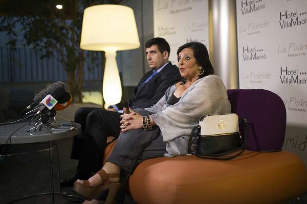 In this photo taken on Wednesday, July 19, 2017, Pilar Abel, right, talks to journalists next to her lawyer Enrique Blanquez during a news conference in Madrid, where she claimed to be the daughter of eccentric artist Salvador Dali.  61-year old Abel claims that her mother had an affair with Salvador Dali while working as a domestic helper in the northeastern Spanish town of Figueres, where the artist was born and lived with his Russian wife Gala.  After two decades of court battles, a Madrid judge granted Abel a DNA test to find out whether her allegations are true, and the exhumation is scheduled to begin Thursday night.(AP Photo/Francisco Seco)
