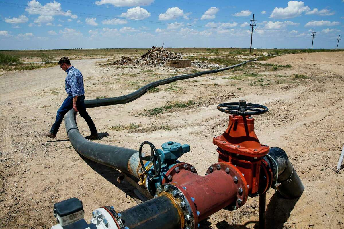 A hose that connects a water well to Layne Christensen's new pipeline, which runs 20 miles from Pecos in far West Texas to oil and gas fields to the north.