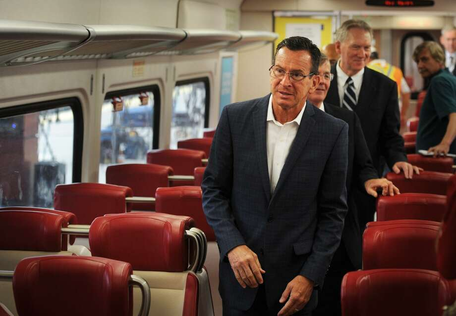 Governor Dannel P. Malloy tours a new Metro North commuter train car following his announcement on improvements for the New Haven Line at Union Station in New Haven, Conn. on Monday, July 27, 2015. Photo: Brian A. Pounds / Hearst Connecticut Media / Connecticut Post