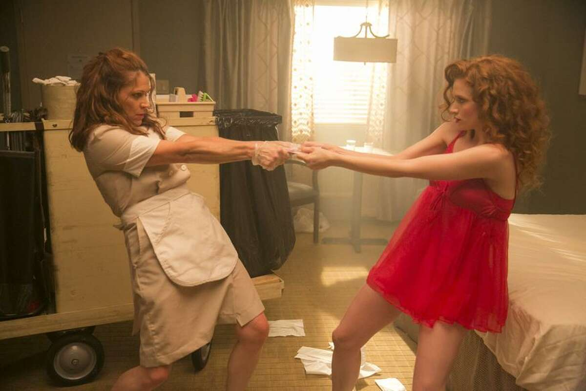 A housekeeper (Dendrie Taylor, left) meets her younger self (Sarah Hay) in